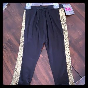 Black drawstring pants with gold speckle sides